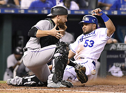 August 22, 2017 - Kansas City, MO, USA - The Kansas City Royals' Melky Cabrera (53) scores before the tag from Colorado Rockies catcher Jonathan Lucroy on an infield chopper by Eric Hosmer in the fourth inning at Kauffman Stadium in Kansas City, Mo., on Tuesday, Aug. 22. 2017. (Credit Image: © John Sleezer/TNS via ZUMA Wire)