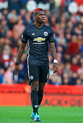 STOKE-ON-TRENT, ENGLAND - Saturday, September 9, 2017: Manchester United's Paul Pogba, with dyed red hair, during the FA Premier League match between Stoke City and Manchester United at the Bet365 Stadium. (Pic by David Rawcliffe/Propaganda)