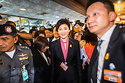 "09 JANUARY 2105 - BANGKOK, THAILAND: YINGLUCK SHINAWATRA, former Prime Minister of Thailand, walks to a waiting car after presenting her defense during her impeachment at the National Legislative Assembly. Thailand's military-appointed National Legislative Assembly began impeachment hearings Friday against former Prime Minister Yingluck Shinawatra. If she is convicted, she could be forced to stay out of politics for five years. During her defense, Yingluck questioned the necessity of her impeachment, saying, ""I was removed from office, the equivalent of being impeached, three times already, I have no position left to be impeached from."" A decision on her impeachment is expected by the end of January.    PHOTO BY JACK KURTZ"
