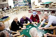 Men play poker at the Sundial Men's Club in Sun City, Arizona December 12, 2009.