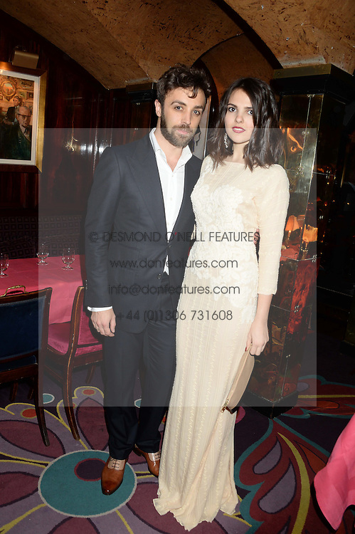 DANIEL DYKES and DOINA CIOBANU at Tatler Magazine's Little Black Book Party held at Annabel's, Berkeley Square, London on 5th November 2013.