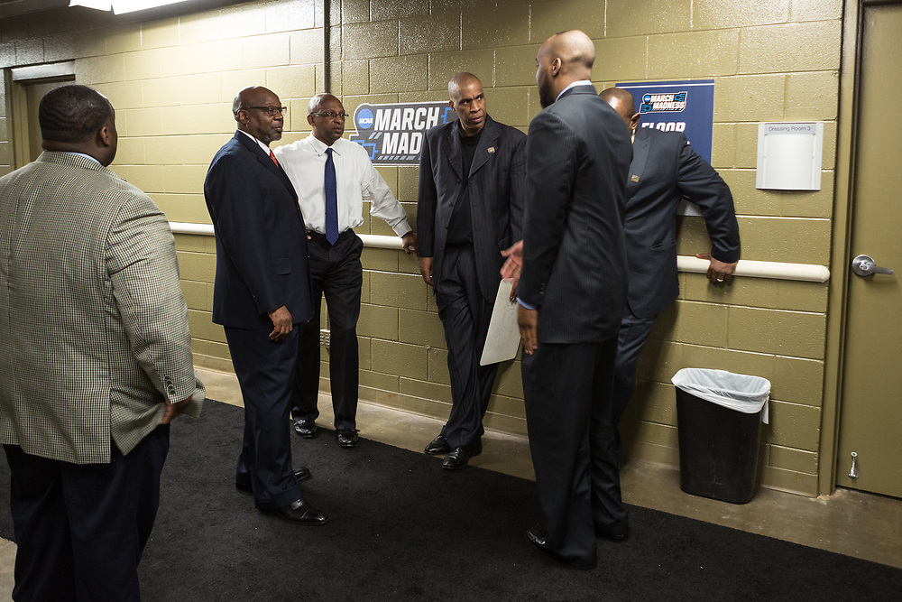 Greenville, South Carolina - March 17, 2017: Coach Tim Waller, Coach Donnie Marsh and Coach Mike Davis talk in the hallway during halftime of the game. The TSU Tigers played the UNC Tarheels in the first round of the 2017 NCAA Men's Tournament (Michael Starghill, Jr. for The Undefeated)