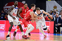 Real Madrid's Othello Hunter and Luka Doncic and Crvena Zvezda Mts Belgrade's Nemanja Dangubic during Turkish Airlines Euroleague match between Real Madrid and Crvena Zvezda Mts Belgrade at Wizink Center in Madrid, Spain. March 10, 2017. (ALTERPHOTOS/BorjaB.Hojas)