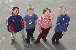 Multiracial group of children standing in school playground,