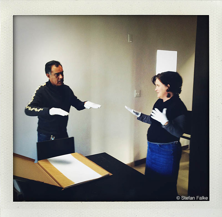 Photographer Julian Cardona and Kerry Doyle, director of the Rubin Center in El Paso, viewing prints for an exhibition at Cordona's house in Juarez, Mexico...http://www.facebook.com/LaFronteraArtistsAlongTheUsMexicanBorder.www.stefanfalke.com..