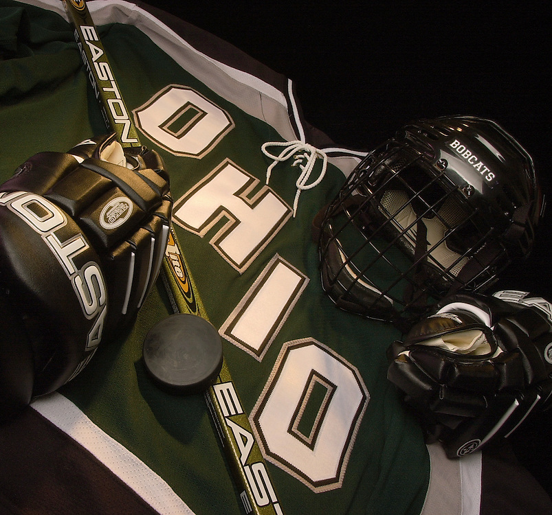 Hockey Gloves, Mask, puck shot for Cover of Hockey media Guide