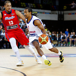GB men vs Puerto Rico basketball at the Copper Box Arena. Justin Robinson (07) passes Angel R. Rosa (13).11/08/2013 (c) MATT BRISTOW
