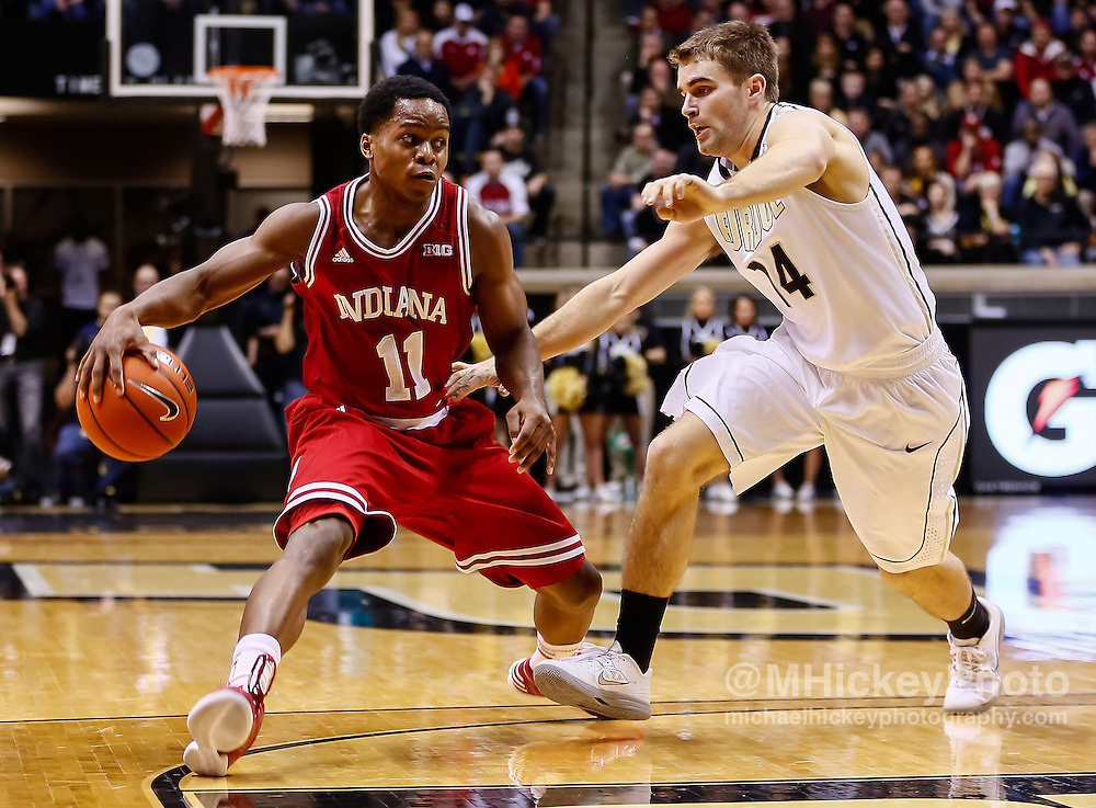WEST LAFAYETTE, IN - JANUARY 30: Kevin Ferrell #11 of the Indiana Hoosiers dribbles the ball as Dru Anthrop #14 of the Purdue Boilermakers  at Mackey Arena on January 30, 2013 in West Lafayette, Indiana. Indiana defeated Purdue 97-60. (Photo by Michael Hickey/Getty Images) *** Local Caption *** Kevin Ferrell; Dru Anthrop