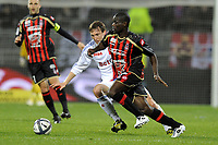 FOOTBALL - FRENCH CHAMPIONSHIP 2010/2011 - L1 - OLYMPIQUE LYONNAIS v OGC NICE - 14/11/2010 - PHOTO JEAN MARIE HERVIO / DPPI - EMERSE FAE (OGCN) / KIM KALLSTROM (OL)