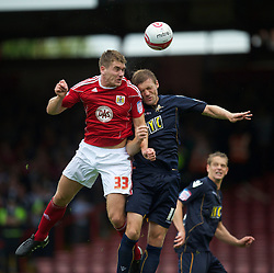 BRISTOL, ENGLAND - Saturday, August 7, 2010: Bristol City's Sam Vokes in action against Millwall's Darren Ward during the League Championship match at Ashton Gate. (Pic by: David Rawcliffe/Propaganda)
