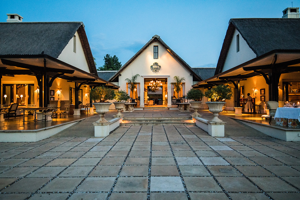 The lit up front entrance of the Royal Livingstone Hotel at dusk Livingstone, Zambia