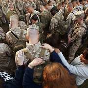 CAMP LEJUNE, NC  - NOVEMBER 3:  The family of Lance Corporal Joseph Ward (center) lays hands on him during a group prayer before marines in the 3rd Battalion, 10th Marine Regiment, prepare to deploy to Afghanistan in support of Operation Enduring Freedom at Camp Lejeune, N.C. on November 3, 2009. His family includes (l-r) sister Veronica Warner, mother Edna Ward, wife Phylicia Ward (at his side) and Mother-in-law Phyllia Hick. Once in Afghanistan the unit will fall under the 2nd Marine Expeditionary Brigade -Afghanistan. The battalion's mission will be to support combat operations as an artillery battalion. (Photo by Logan Mock-Bunting/Getty Images)