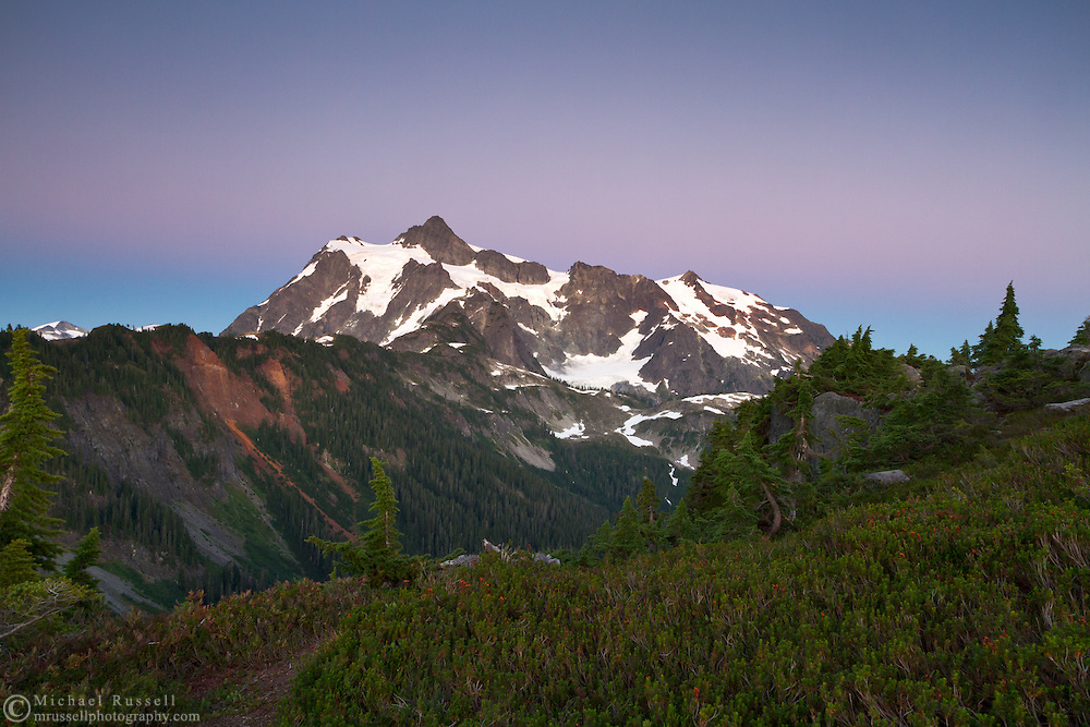 "After direct sunlight/alpenglow had left Mount Shuksan, this band of purple and blue known as the ""Belt of Venus"" rose in the sky.  Photo made from Kulshan Ridge in the Mount Baker-Snoqualmie National Forest in Washington State, USA."
