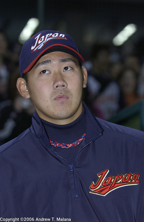 Team Japan starter Daisuke Matsuzaka looks up while listening to a reporter's question before the game against Team Korea in the World Baseball Classic at Tokyo Dome, Tokyo, Japan.