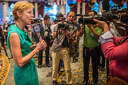 07 NOVEMBER 2012 - BANGKOK, THAILAND:   KRISTIE KENNEY, the US Ambassador to Thailand, does a live video feed for the Embassy's web site at the Embassy's election watching party in Bangkok. US President Barack Obama won a second term Tuesday when he defeated Republican Mitt Romney. Preliminary tallies gave the President more than 300 electoral votes, well over the 270 needed to win. The election in the United States was closely watched in Thailand, which historically has very close ties with the United States. The American Embassy in Bangkok sponsored an election watching event which drew thousands to a downtown Bangkok hotel. American Democrats in Bangkok had their own election watch party at a restaurant in Bangkok.     PHOTO BY JACK KURTZ