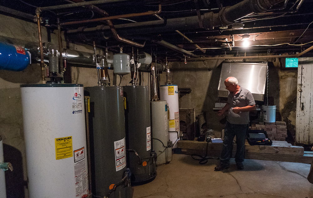 Mike Lehman from the Coporation for Appalachian Development (COAD) prepares to inspect the hot water heaters at 47 West Washington Street during an energy audit on Tuesday, June 23, 2015.  Photo by Ohio University  /  Rob Hardin