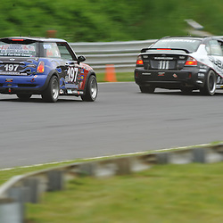 May 23, 2009; Lakeville, CT, USA; The RSR Motorsport Mini Cooper S driven by Jade Buford and Owen Trinkler chases the Subaru Road Racing Team Legacy of Andrew Aquilante and Kristian Skavnes in the Grand-Am Koni Sports Car Challenge series competition during the Memorial Day Road Racing Classic weekend at Lime Rock Park.