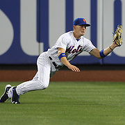 NEW YORK, NEW YORK - July 01: Brandon Nimmo #9 of the New York Mets makes a catch in right field to dismiss pitcher Jason Hammel #39 of the Chicago Cubs during the Chicago Cubs Vs New York Mets regular season MLB game at Citi Field on July 01, 2016 in New York City. (Photo by Tim Clayton/Corbis via Getty Images)