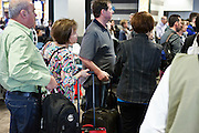 people waiting at the gate for boarding airplane
