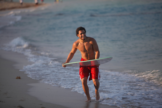 4/1/13---Miami Beach, Florida---Photo by Angel Valentin<br /> Jose Gabriel skim boarding in Miami Beach.