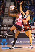 Carla Borrego takes the ball for the Thunderbirds with Jess Moulds of the Tactix in defence during the ANZ Championship Netball game between the Mainland Tactix v Adelaide Thunderbirds at Horncastle Arena in Christchurch. 20th April 2015 Photo: Joseph Johnson/www.photosport.co.nz