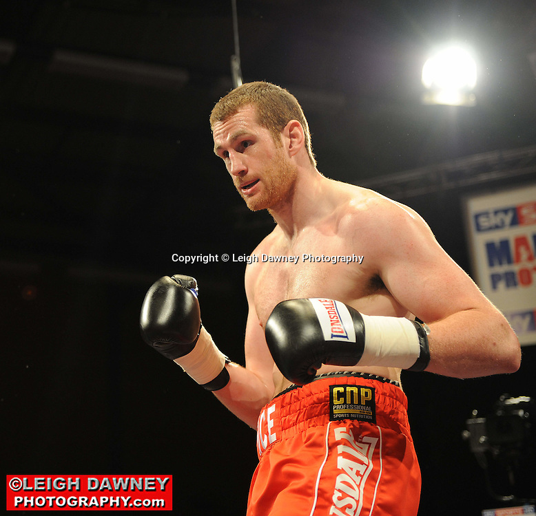 David Price (red shorts) defeats Daniil Peretyatko at Gorsebrook Leisure Centre Dagenham on 14th May 2010. Frank Maloney Promotions. Photo credit: © Leigh Dawney