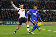 Derby County striker Johnny Russell and Birmingham City midfielder David Davis challenge for the ball during the EFL Sky Bet Championship match between Derby County and Birmingham City at the iPro Stadium, Derby, England on 27 December 2016. Photo by Aaron  Lupton.