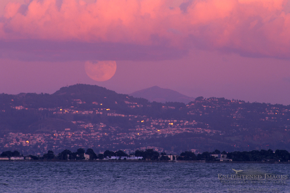 Full moon rising at sunset over the Oakland Hills and Mount Diablo, seen from Rincon Park, San Francisco, California