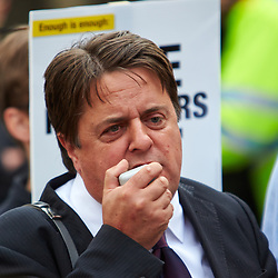 © Licensed to London News Pictures.  01/06/2013. LONDON, UK. BNP leader Nick Griffin (pictured) addresses a rally of supporters outside the Houses of Parliament. Police were forced to separate rival protests by the BNP and anti-fascist groups in Whitehall. The BNP initially wanted to march in Woolwich, scene of the murder of a solider recently, but were banned by police from doing so.  Photo credit: Cliff Hide/LNP