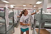 A student offers her service at Akron's Haven of Rest shelter on Freshman Volunteer Day.
