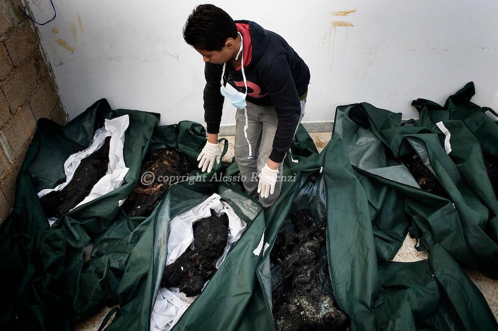 Libya, Benghazi. A nurse shows the charred bodies of 9 people on February 26, 2011. ALESSIO ROMENZIALESSIO ROMENZI