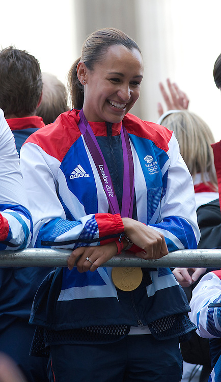 © London News Pictures. 10/09/2012. London, UK . Heptathlon gold medalist Jessica Ennis waving from a float. Athletes take part in an open top bus victory parade through central London on September 10, 2012 to honour achievements of Team GB in both the Olympic and Paralympic Games. Photo credit: Ben Cawthra/LNP