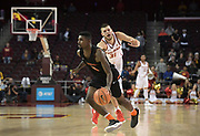 Dec 19, 2017; Los Angeles, CA, USA; Princeton Tigers guard Amir Bell (5) dribbles the ball as Southern California Trojans forward Nick Rakocevic (31) defends during an NCAA basketball game at Galen Center. Princeton defeated USC 103-93 in overtime.
