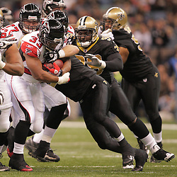 2008 December, 07: Atlanta Falcons running back Michael Turner (33) is tackled by New Orleans Saints linebacker Scott Fujita (55)during 29-25 victory by the New Orleans Saints over NFC South divisional rivals the Atlanta Falconsat the Louisiana Superdome in New Orleans, LA.