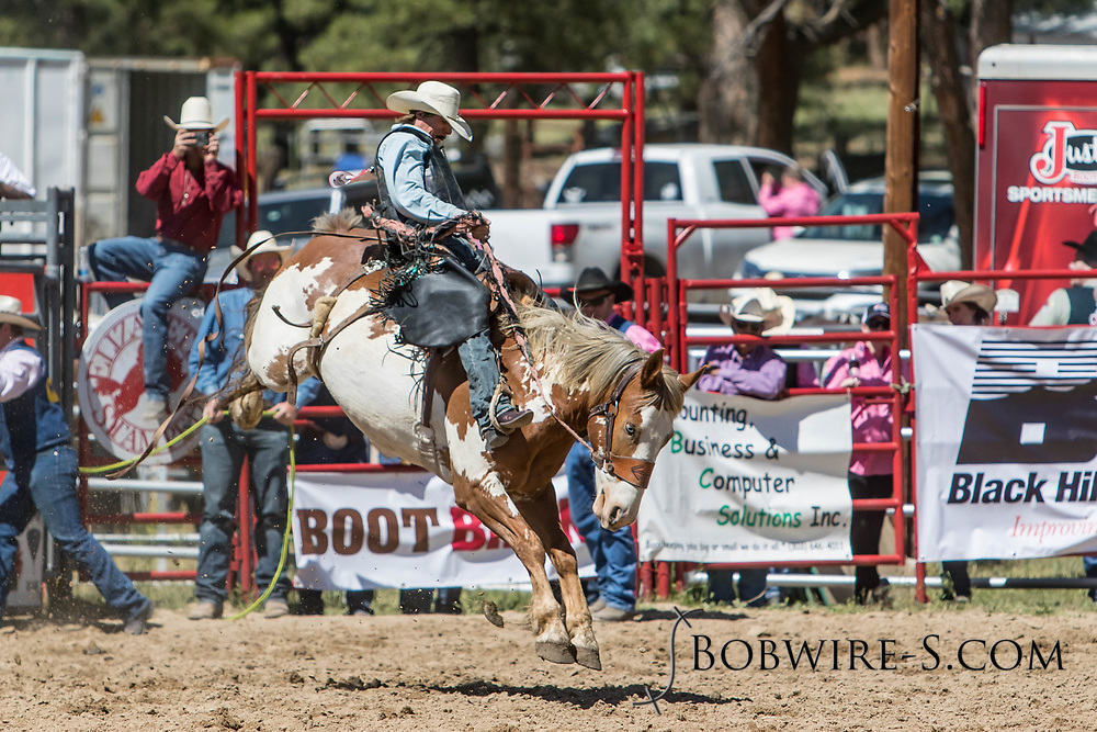 Saddle bronc rider Garrett Uptain rides Summit Pro Rodeo's 947 Spotted Rabbit in the first performance of the Elizabeth Stampede on Saturday, June 2, 2018.
