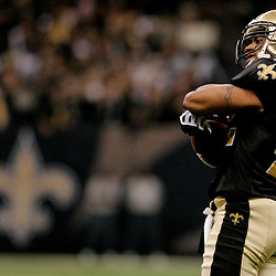 2009 November 30:  New Orleans Saints safety Darren Sharper (42) celebrates after intercepting a pass during a 38-17 win by the New Orleans Saints over the New England Patriots at the Louisiana Superdome in New Orleans, Louisiana.