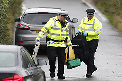 © Licensed to London News Pictures. 16/08/2019. Sulhamstead, UK. Police collect medical equipment from Ufton Lane near Sulhamstead, Berkshire, where a police officer was killed while investigating a suspected burglary. Ten people have been arrested on suspicion of murder including a 13-year-old child. Photo credit: Peter Macdiarmid/LNP