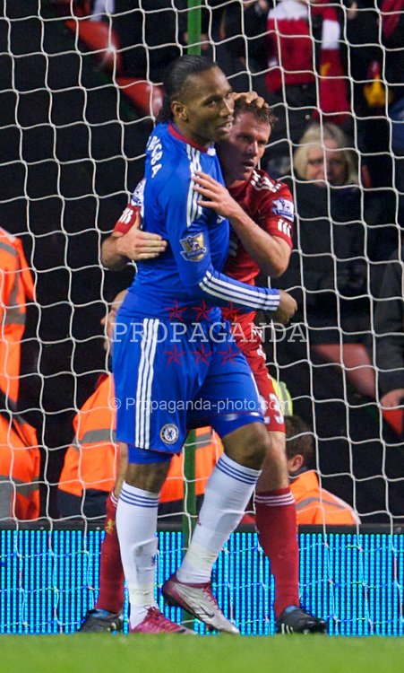 LIVERPOOL, ENGLAND - Sunday, November 7, 2010: Liverpool's Jamie Carragher and Chelsea's Didier Drogba embrace during the Premiership match at Anfield. (Photo by David Rawcliffe/Propaganda)