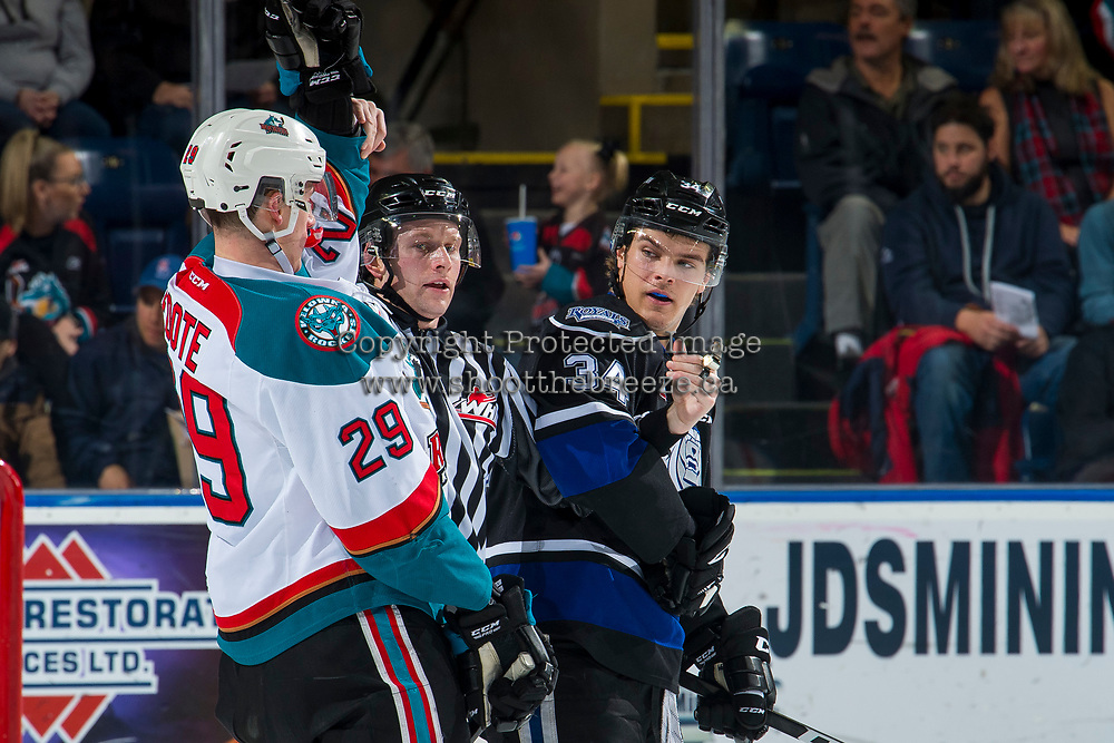 KELOWNA, CANADA - JANUARY 25: Linesman Dave McMahon gets between Nolan Foote #29 of the Kelowna Rockets and Kaid Oliver #34 of the Victoria Royals on January 25, 2019 at Prospera Place in Kelowna, British Columbia, Canada.  (Photo by Marissa Baecker/Shoot the Breeze)