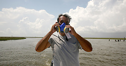 07 June 2010. Pointe aux Chenes, Louisiana.<br /> Fading away. Russel Darden, a shrimper, crabber, oysterman, fisherman. Russel puts on his respirator whenever he smells oil thick in the air. Russel holds over $1,000 worth of various fishing permits issued by the state. At present, all his fishing grounds are closed. He can not make use of any of the permits and he can not earn the money to make up the money. Russel is a member of the Pointe aux Chenes Indians, settlers that can trace their roots beyond 5 generations back to France. French cajun is the language of the elders, but is dying out in the children of today. BP's catastrophic oil spill threatens the tribe's very existence, their way of life and the land on which they live. Not recognised by the federal government, the 680 member tribe struggles for funds in a small community that survives only because of fishing and oil extraction in the Gulf of Mexico.<br /> Photo; Charlie Varley/varleypix.com