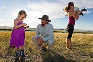 Zachary Jones, general manager of the Twodot Land and Livestock Company, explores the ranch land with Shannon Agee-Jones, his wife, and two daughters, River, 2, and Scotland, 4, on June 21, 2012 near Harlowton, Montana. Zachary Jones, who co-founded and manages Yellowstone Grassfed Beef, works towards economic and ecological sustainability using holistic management techniques on his family's 5th generation 24000-acre ranch. <br />