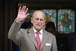 © London News Pictures. 09/06/2012. London, UK. Prince Philip, The Duke of Edinburgh waves as he leaves King Edward VII hospital in London on June 09, 2012 in time to spend his 91st birthday at home tomorrow (Sunday). The Duke of Edinburgh had spent five nights in hospital in Central London after falling during the Queens Diamond Jubilee celebrations. Photo credit: Ben Cawthra/LNP