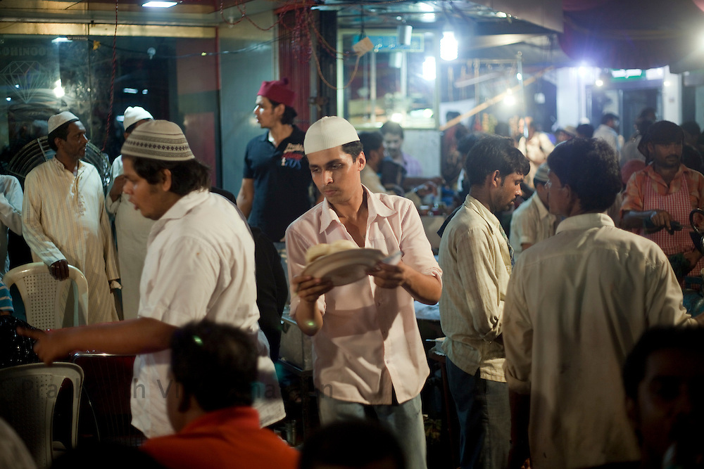 Abdullah Nasir serves customers and runs the stall at the largets food stall, opposite Minara masjid at Mohammed Ali road in Mumbai, Maharashtra, India, on Saturday September 6, 2009. Photographer: Prashanth Vishwanathan/The National