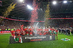 CARDIFF, WALES - Tuesday, October 13, 2015: Wales players celebrate qualifying for the finals after a 2-0 victory over Andorra during the final UEFA Euro 2016 qualifying Group B match at the Cardiff City Stadium. Joe Allen, Gareth Bale, Joe Ledley. (Pic by Barry Coombs/Propaganda)