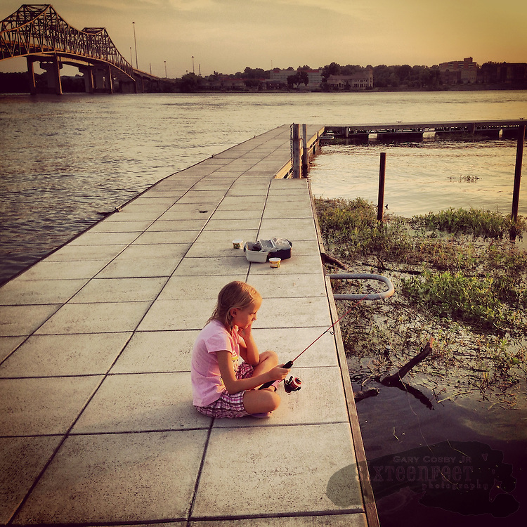 Gary Cosby Jr.  iPhone photographs  A child fishes from a pier on the Tennessee River at Decatur, Alabama.