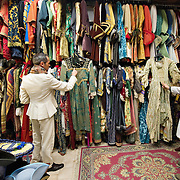 VENICE, ITALY - JANUARY 20:  Choreographer Raffaele Dessi (L) and tailor Francesco Briggi (R) of the historic atelier Pietro Longi check few costumes on January 20, 2012 in Venice, Italy. This is one of the busiest periods of the year for the atelier as the next few weeks the streets and canals of Venice will be filled with people attending the carnival,  wearing highly-decorative and imaginative carnival costumes and masks.