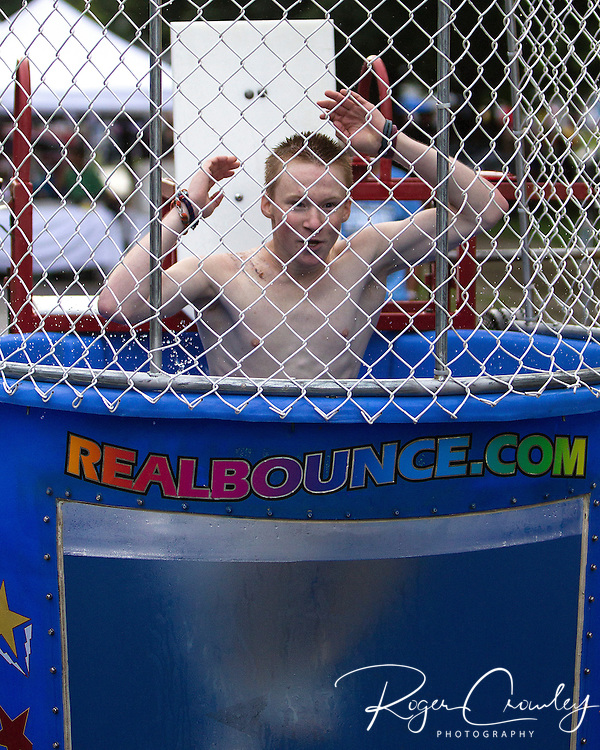 Dalton James of Worcester gets dunked to help raise money for the U32 Hockey trip to Europe during the July 3rd celebration on State Street in Montpelier.
