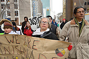 Loreena Garvey-Shepley, centre, and two others people hold a sign as about fifty people march from a courthouse to a main street in downtown Windsor, Ontario, Canada as part of the Colten Boushie prayer rally. The event is the second one in Windsor following the 09 February 2018 not guilty verdict in the Boushie case.