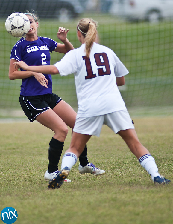 Cox Mill's Ashley MacCoy (2) and Jay M. Robinson's Mikayla Shaw (19) fight for the ball during a South Piedmont Conference matchup at Jay M. Robinson High School Thursday afternoon. Cox Mill won the game 3-0. (Photo by James Nix)