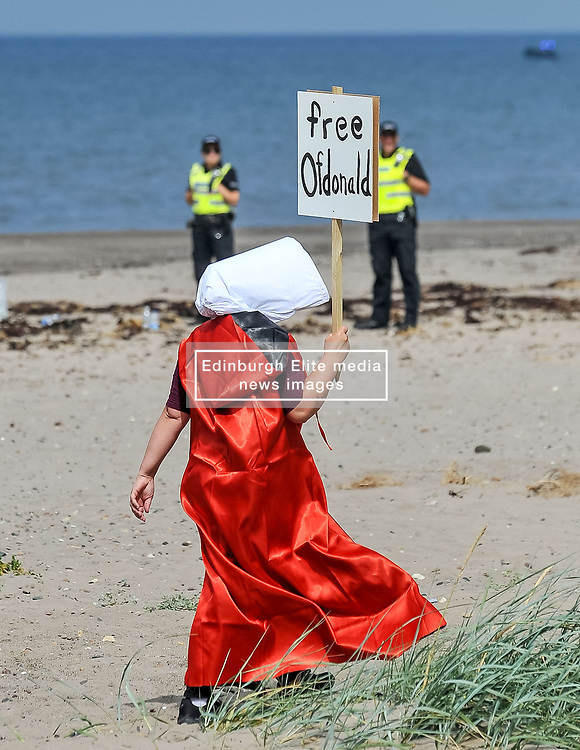 Protesters gathered amid tight security at the Trump Turnberry resort, where President Trump and his wife Melania are staying on their trip to Scotland.<br /> <br /> © Dave Johnston / EEm